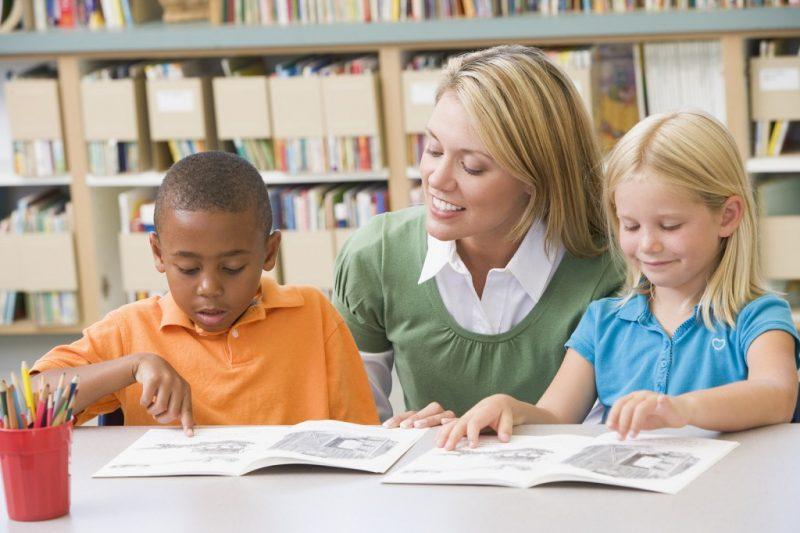 Kids reading with Teacher