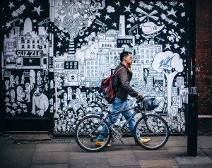 Man Walking With Bicycle Graffiti Background